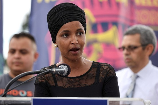 WASHINGTON, DC - SEPTEMBER 21: Rep. Ilhan Omar (D-MN) addresses thousands of demonstrators from across the country as they rally in support of a pathway to citizenship for the more than 11 million undocumented immigrants living in the United States on the National Mall on September 21, 2021 in Washington, DC. Activists, union leaders, organizers and political leaders addressed the marchers as they rallied outside the headquarters of the U.S. Immigration and Customs Enforcement and the U.S. Capitol. (Photo by Chip Somodevilla/Getty Images)